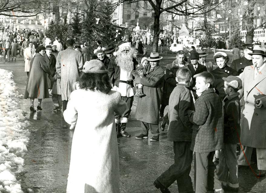 Dec. 16, 1956: Globe Santa attracted a crowd of people wanting to have pictures taken with him. This was the inaugural year of the Boston Globe Santa Claus Fund. The Boston Post started the Santa Fund in 1910. When the Post closed earlier this year, The Boston Globe with Mayor John Hynes continued the long tradition of providing Christmas toys for needy families.
